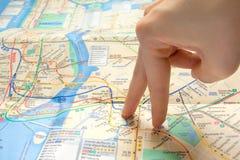 走在地图的手指 库存图片