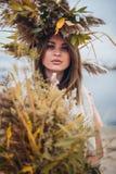 走在芦苇的女孩 图库摄影