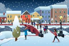 走在镇里的人们在冬天例证时 库存照片