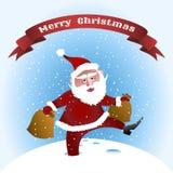 走的圣诞老人 免版税库存照片