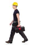 走的安装工运载的工具箱 免版税库存照片