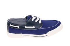 走的蓝色鞋子 免版税库存图片