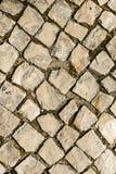 走道鹅卵石 被修补的路纹理 免版税图库摄影