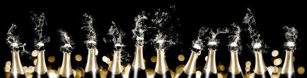 起泡沫和飞溅香槟装瓶横幅 免版税库存照片