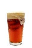起泡沫在玻璃的啤酒 库存照片