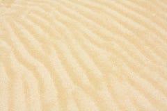 起波纹的沙子模式背景 库存照片