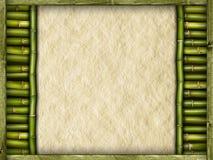 起皱纹的纸在竹棍子 免版税库存图片