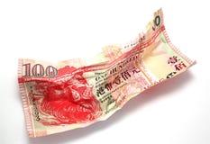 起皱纹的香港$100美元 免版税库存照片