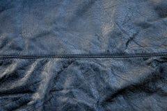 起皱纹的黑皮革 免版税库存照片