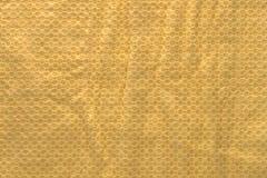起皱纹的黄色聚乙烯纹理 库存照片