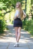 超短裙的性感的女孩 库存图片