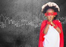 超级孩子画象在红色海角和红色面具的 库存图片