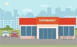 超级市场大厦和两辆汽车在城市背景 库存图片