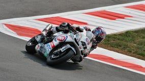 超级摩托车队Pata赛跑的Aprilia Noriyuki Haga 图库摄影