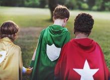 超级英雄哄骗志向想象力嬉戏的乐趣概念 库存照片