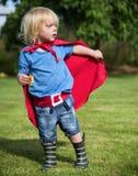 超级英雄小男孩想象力自由幸福概念 免版税库存图片