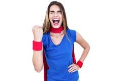 超级英雄服装呼喊的妇女 库存照片