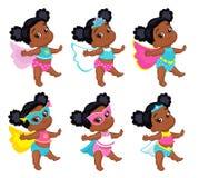 超级英雄服装的可爱的宝贝女孩 免版税库存照片