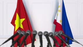 越南和菲律宾旗子在国际会议或交涉新闻招待会 3D动画 股票录像