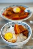 越南语在椰子水中炖了猪肉用午餐的米 免版税库存照片