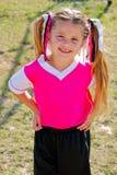 年轻足球女孩画象领域的在比赛期间 免版税图库摄影