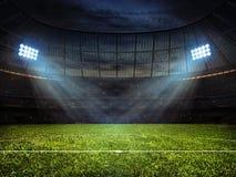足球有泛光灯的橄榄球场 库存图片
