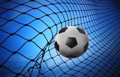 足球橄榄球射击到目标净额里 库存图片