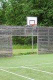 足球目标和篮球篮在室外操场 免版税库存图片