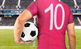 足球红色队的足球运动员 库存图片