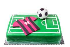 足球运动员、橄榄球场和T恤杉的生日蛋糕 免版税库存照片