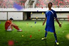 足球运动员庆祝目标胜利 库存图片