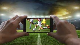 足球迷去除橄榄球赛 图库摄影