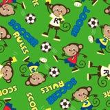 足球统治猴子无缝的样式 库存照片