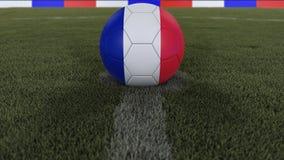 足球/橄榄球经典球在领域草的中心与法国旗子的绘画的与defocused的景深, 3D的 库存照片