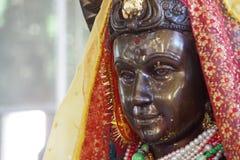 趾缘蜥类在WatMuang的Devi雕象 库存图片
