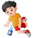 跌倒与罐头的动画片男孩 库存照片