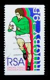 跑与球和剪影,世界杯橄榄球赛serie的球员,大约1995年 库存照片