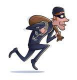 跑与袋子的窃贼战利品 图库摄影