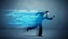 跑与设备和数据概念的商人 免版税图库摄影