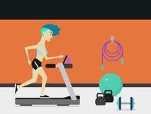 跑在健身房的踏车机器的年轻运动的妇女 图库摄影