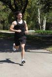 跑在公园的运动员 图库摄影