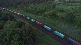 跑在桥梁的货物火车空中射击通过高速公路 影视素材
