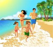 跑在海滩的家庭 库存照片