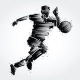跑在球后的足球运动员 免版税库存照片