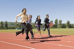 跑在赛马跑道的商人 免版税库存图片