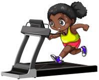 跑在踏车的非裔美国人的女孩 库存照片