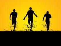 跑在领域的3个人 免版税库存图片