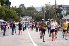 跑在2014位同志Marathon公路赛的参加者 免版税图库摄影