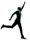 跑愉快的剪影的非洲黑人 免版税库存图片