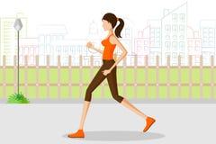 跑步在公园的美丽的妇女 免版税库存图片